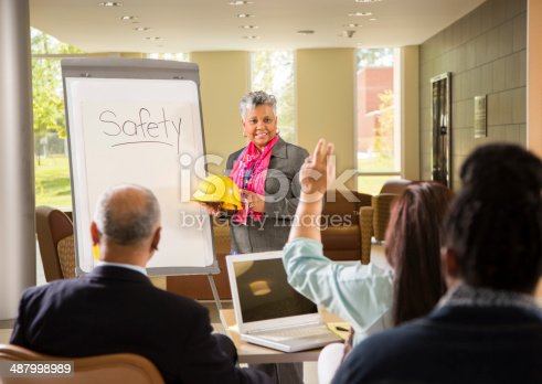 istock Safety in the workplace. Presentation with workers. 487998989