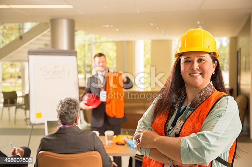 istock Safety in the workplace. Presentation with workers. 498602503