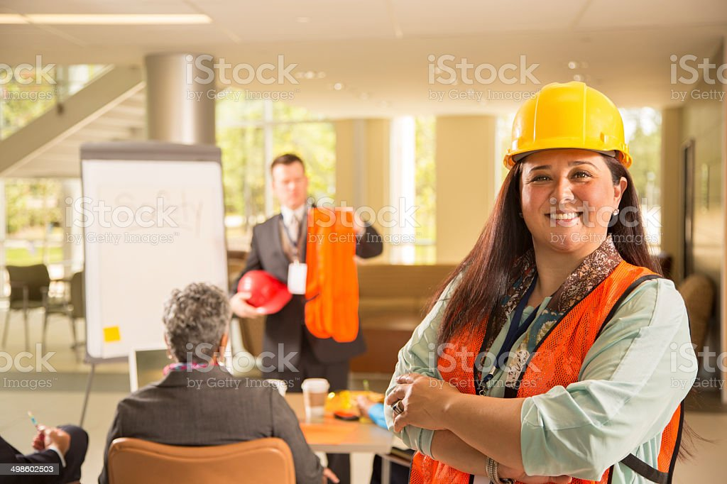 Safety in the workplace. Presentation with workers. stock photo