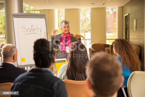 istock Safety in the workplace. Presentation with workers. 498634457