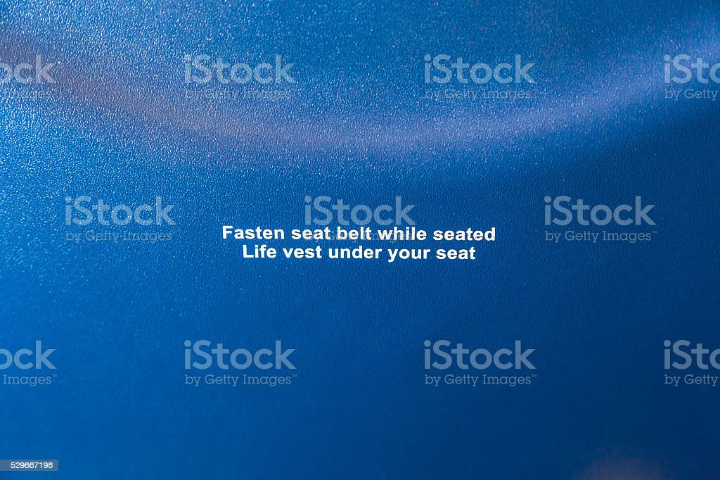 Safety information on aircraft seat. Close up. stock photo
