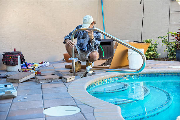 Safety: Installing a pool Hand rail stock photo