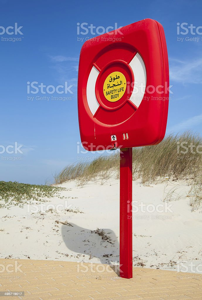 Safety life buoy in red case stand on the beach royalty-free stock photo