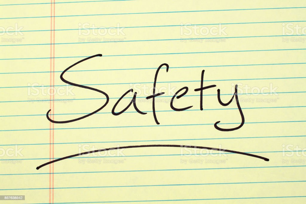 Safety On A Yellow Legal Pad stock photo