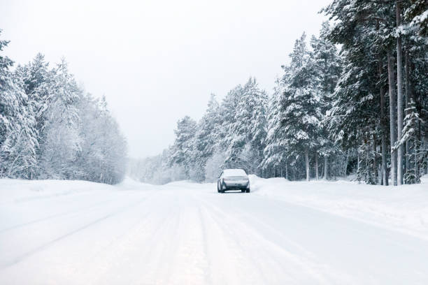 Safety on the winter road Safety on the winter road blizzard stock pictures, royalty-free photos & images