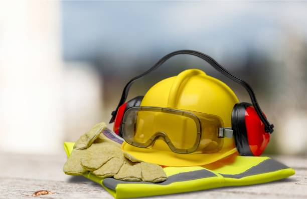 Safety. Safety helmet with earphones and goggles on construction background security equipment stock pictures, royalty-free photos & images