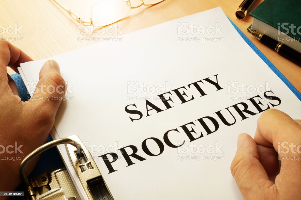 Safety procedures in a blue folder. Work Safety concept. stock photo