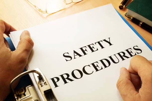 Safety procedures in a blue folder. Work Safety concept. Safety procedures in a blue folder. Work Safety concept. medical procedure stock pictures, royalty-free photos & images