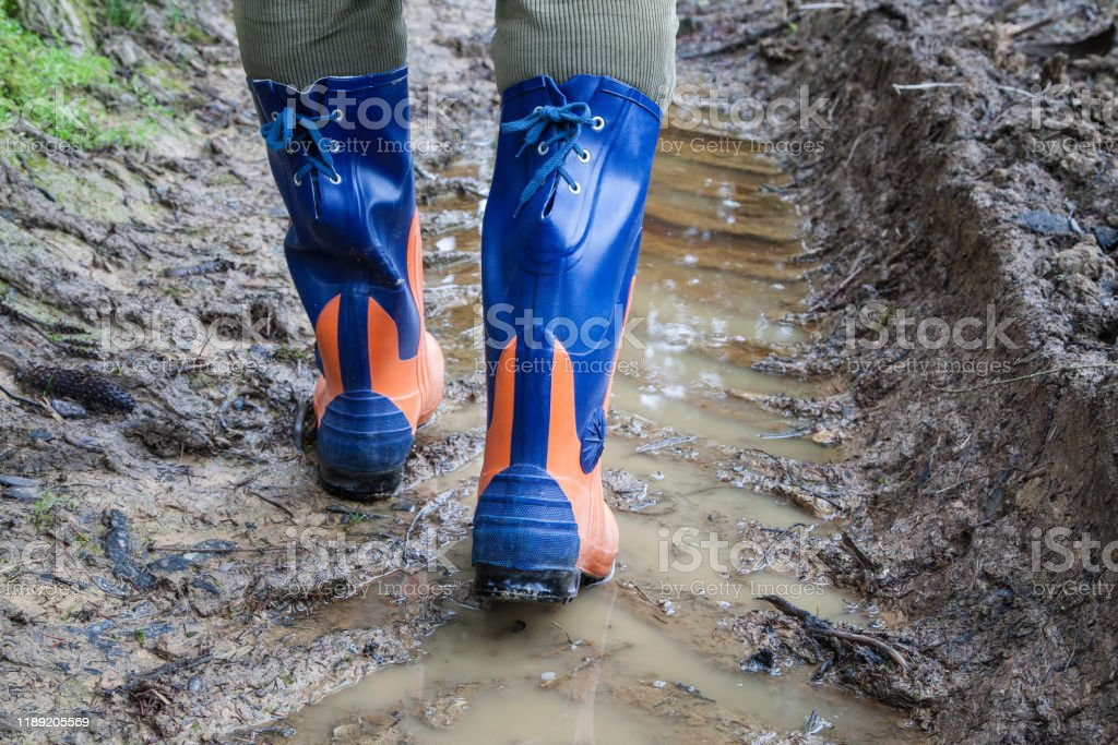 Safety rubber boots for the woodcutter. - Royalty-free Adult Stock Photo