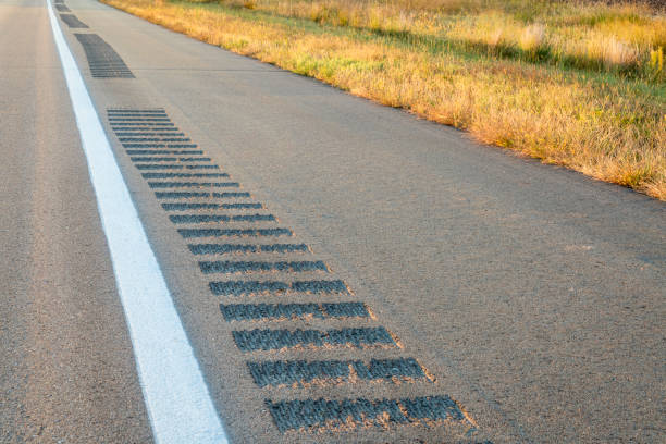safety rumble strips on a highway shoulder stock photo