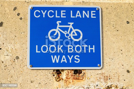A cycle lane sign for safety look both ways, England UK.