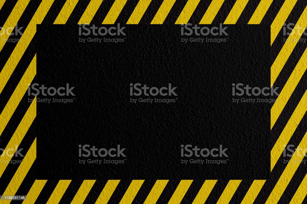 Safety sign yellow and black on mortar texture warning to be careful...
