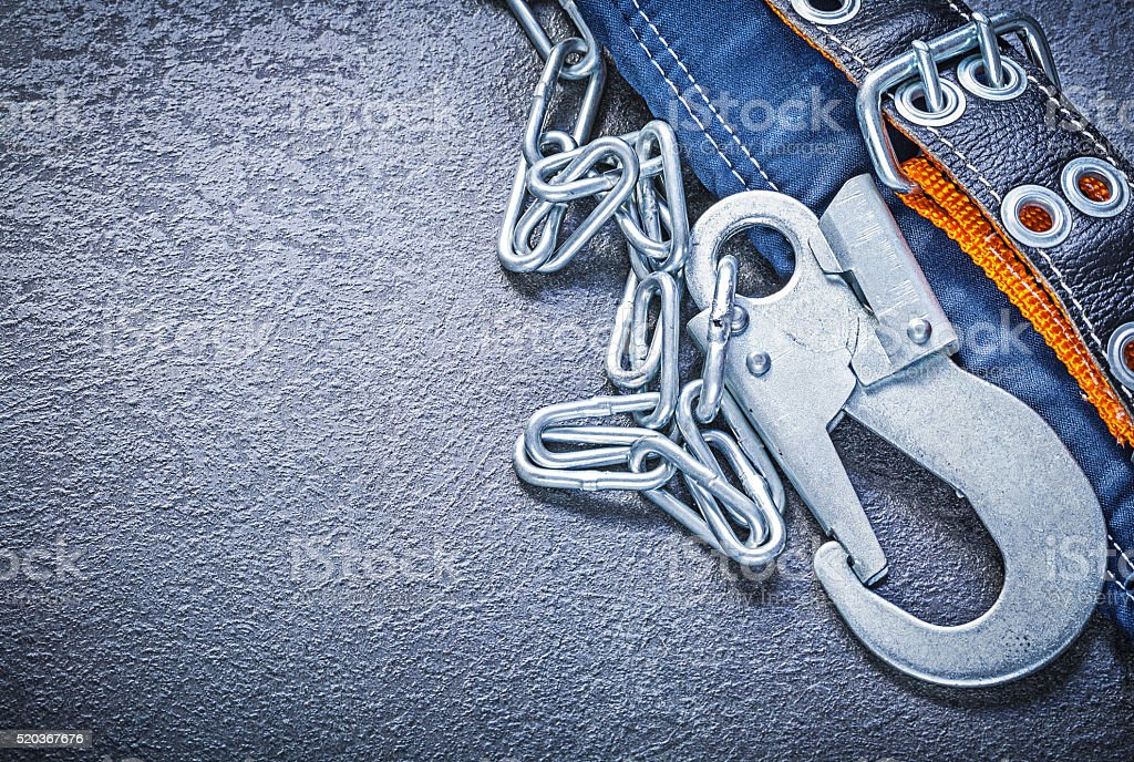 Safety strap with metal chain carabiners on black background dir stock photo