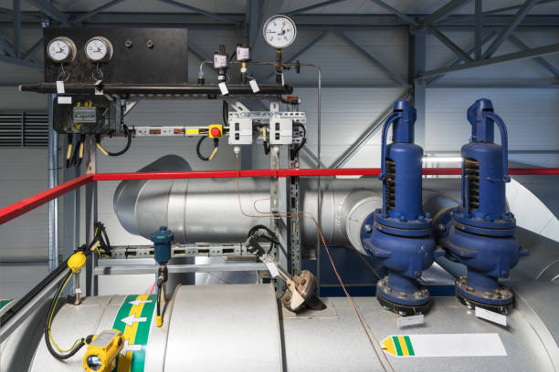 safety valves and pressure gauges - cogeneration plant stock photos and pictures