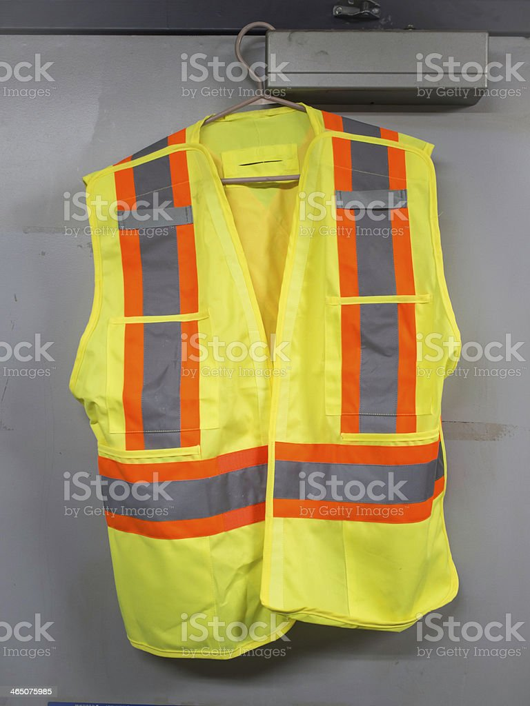 safety vest reflective security hanger yellow orange gray door stock photo