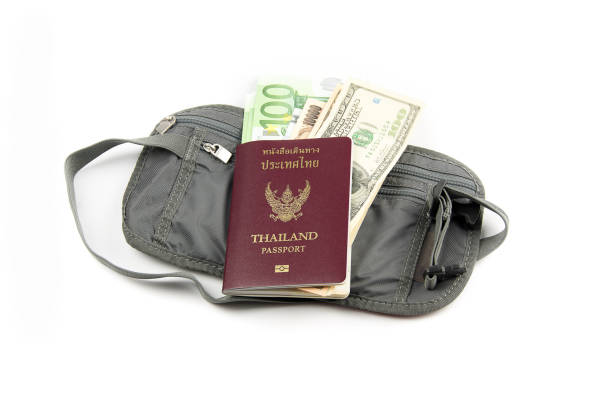 safety waist pouch for traveler with different money and passport - waist bag stock photos and pictures