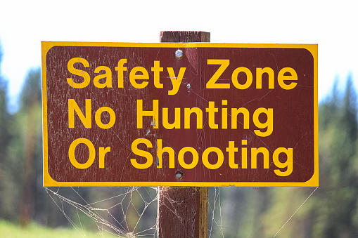 A Safety Zone, No Hunting or Shooting sign
