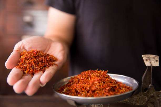 Safflower for diet tea and healthy low fat cooking oil herbal in herb store background Safflower for diet tea and healthy low fat cooking oil herbal in herb store background saffron stock pictures, royalty-free photos & images