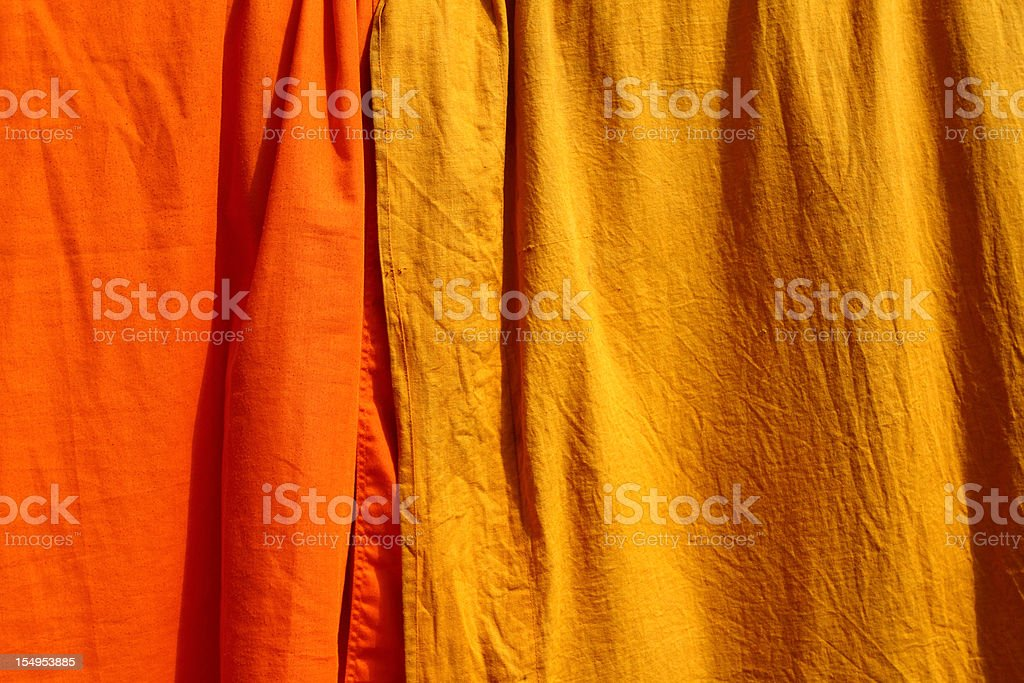 Saffron fabric used by the Buddhist monks stock photo