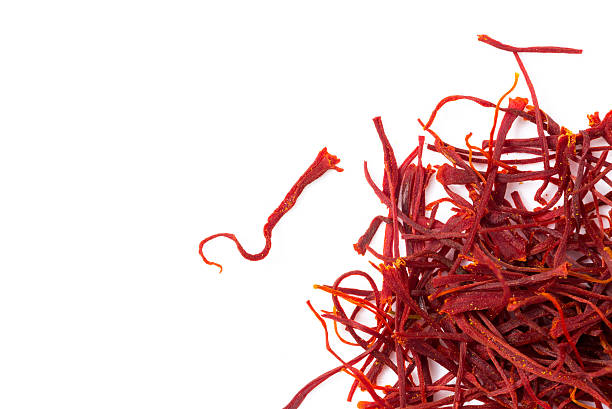 Saffron isolated on white Heap of saffron isolated on white background, closeup, view from above. saffron stock pictures, royalty-free photos & images