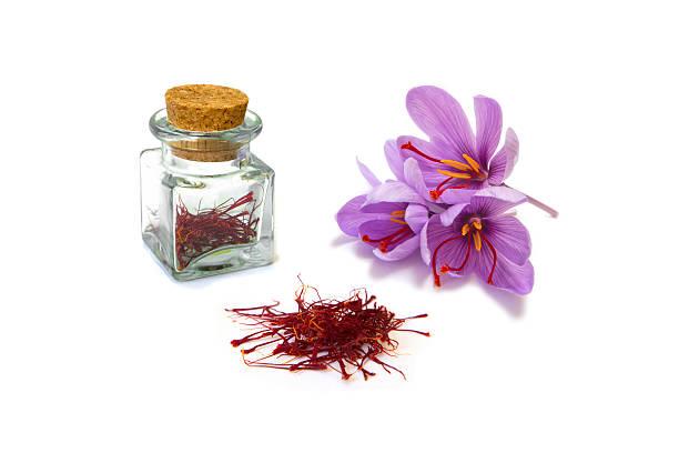 Saffron An image of saffron flowers, dried saffron and saffron stored for use. saffron stock pictures, royalty-free photos & images