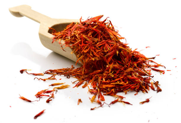 Saffron Scoop of saffron.  Isolated on white. saffron stock pictures, royalty-free photos & images