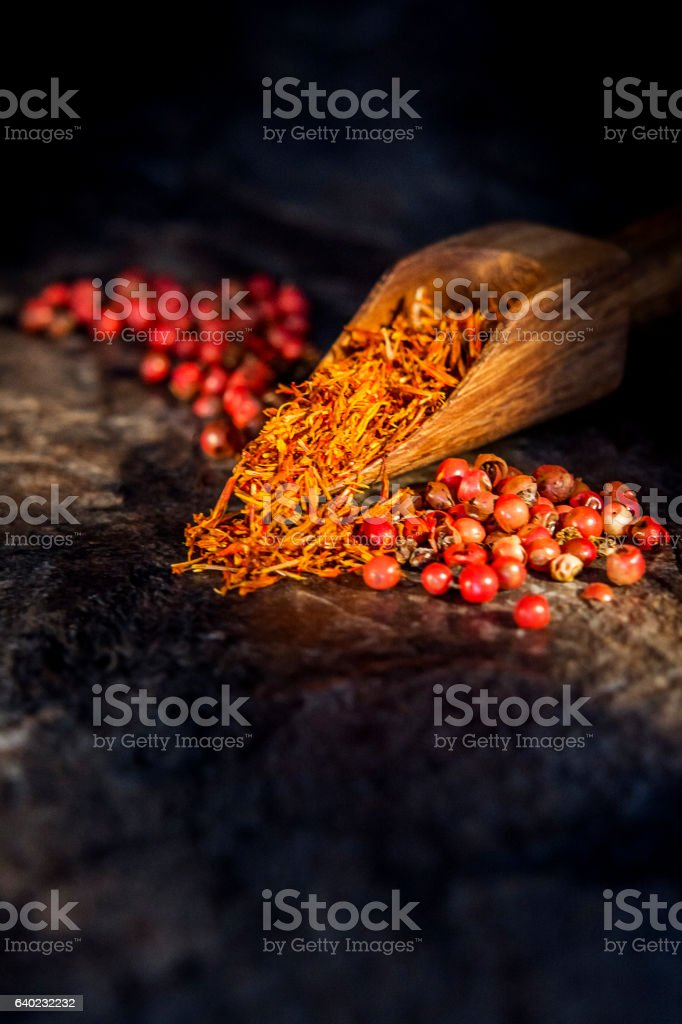 Safran, poivre rose, marbre stock photo