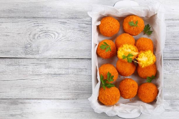 saffron rice balls stuffed with cheese stock photo