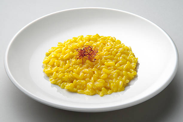 Saffron risotto dish Saffron risotto dish isolated on grey plane saffron stock pictures, royalty-free photos & images