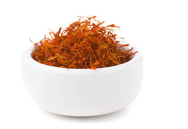 saffron spice in bowl, red spanish seasoning isolated on white - saffron on white bildbanksfoton och bilder