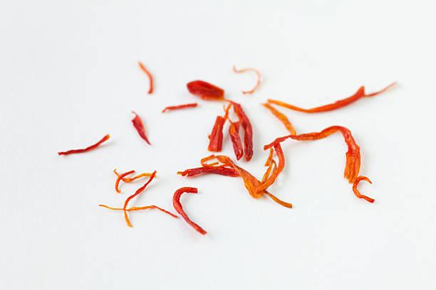 saffron strands - saffron on white bildbanksfoton och bilder