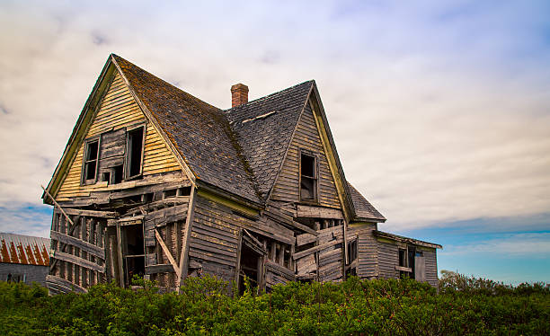 sagging abandon house - abandoned stock photos and pictures