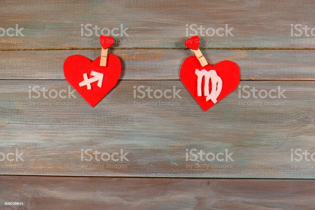 Sagittarius and the virgin. signs of the zodiac and heart. woode stock photo