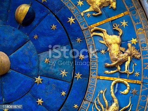 istock Sagittarius astrological sign on ancient clock. Detail of Zodiac wheel with Sagittarius. 1180618747