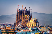 aerial view of Sagrada familia with Barcelona skyline at sunset. Spain