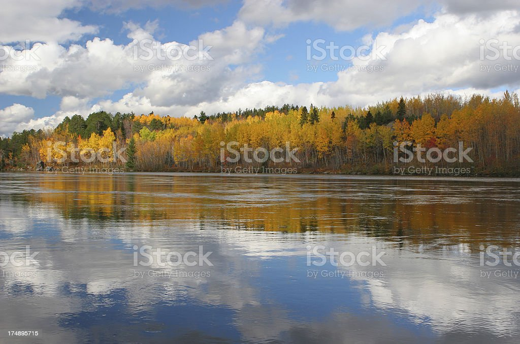 Saguenay River reflection of the sky and the Autumn colors stock photo