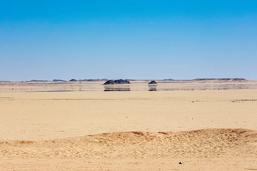A mirage in the Sahara Desert while traveling by car to Abu Simbel