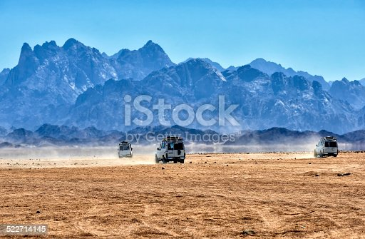 istock Sahara desert with jeeps for safari. 522714145