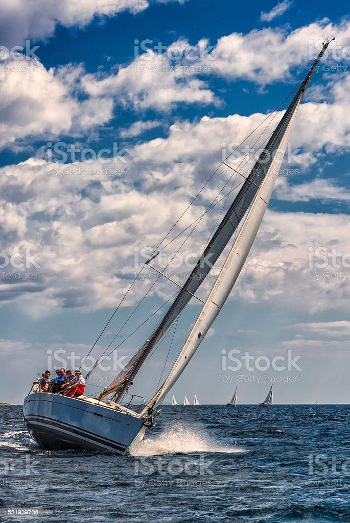Saiboat racing at regatta, front view stock photo