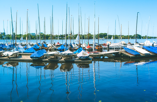 Sail boars for rent on the pier on Alster lake. Hamburg, Germany