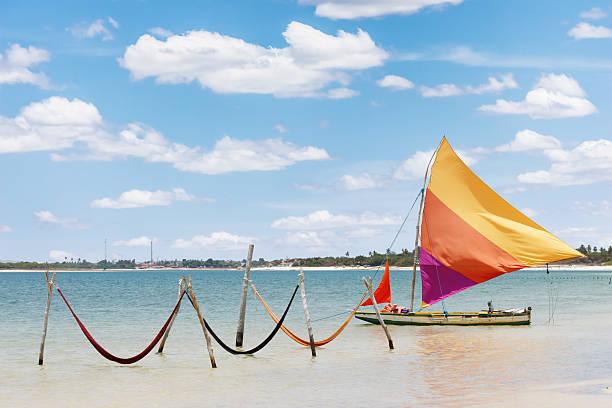 sail boat and hammocks at Jericoacoara, Brazil beautiful sail boat and hammocks at the Paradise Lake (Jericoacoara, Brazil) 2014 stock pictures, royalty-free photos & images
