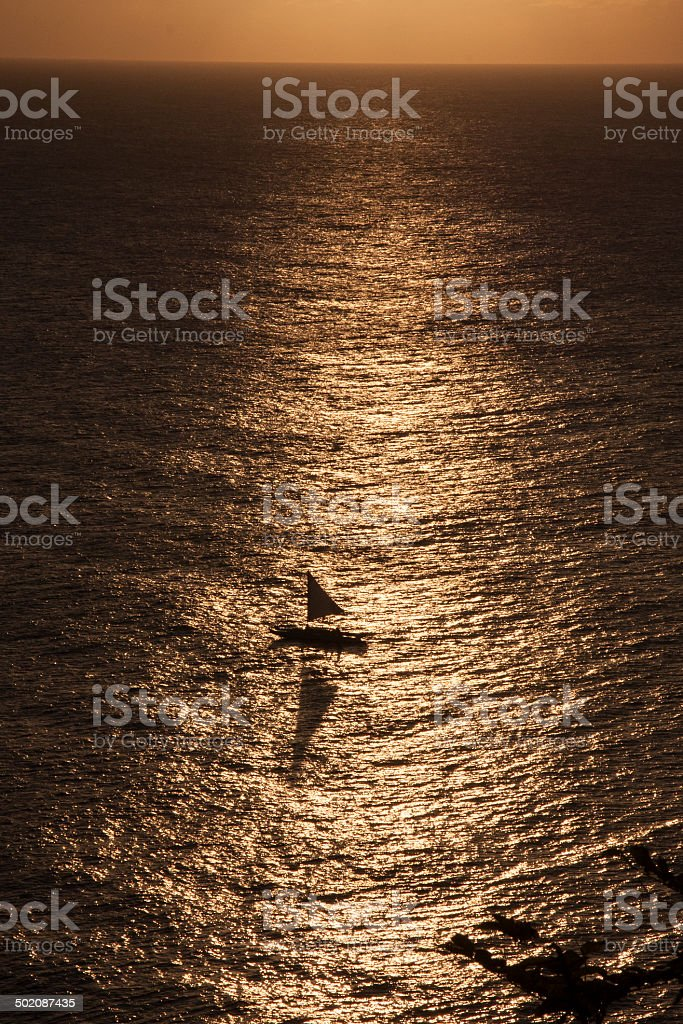 Sail Boat at Sunset stock photo