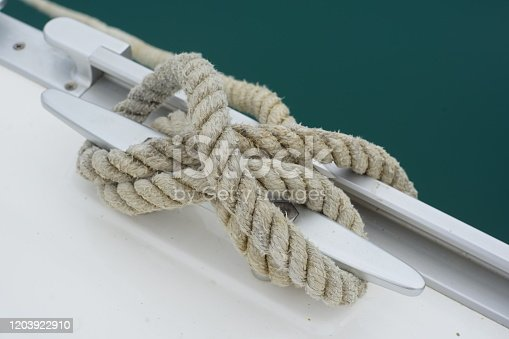 Sail boat docking line on mooring cleat
