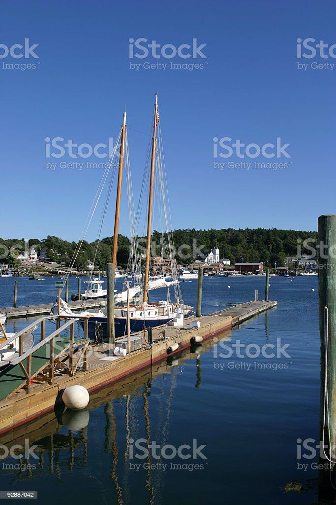 Sail boat near the pier stock photo