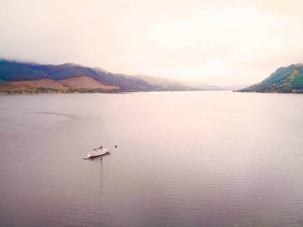 Sail boat on foggy day Photo shows a sail boat on a foggy morning in Scotland highland inverness scotland stock pictures, royalty-free photos & images
