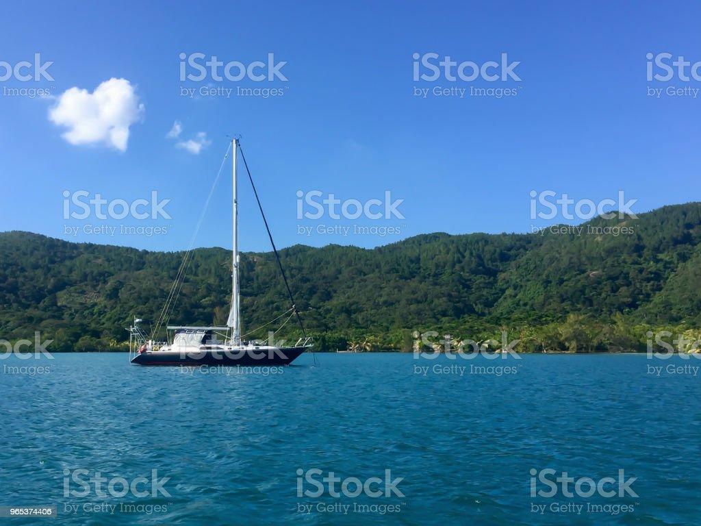 Sail boat on the calm caribbean waters of Guanaja, Honduras royalty-free stock photo