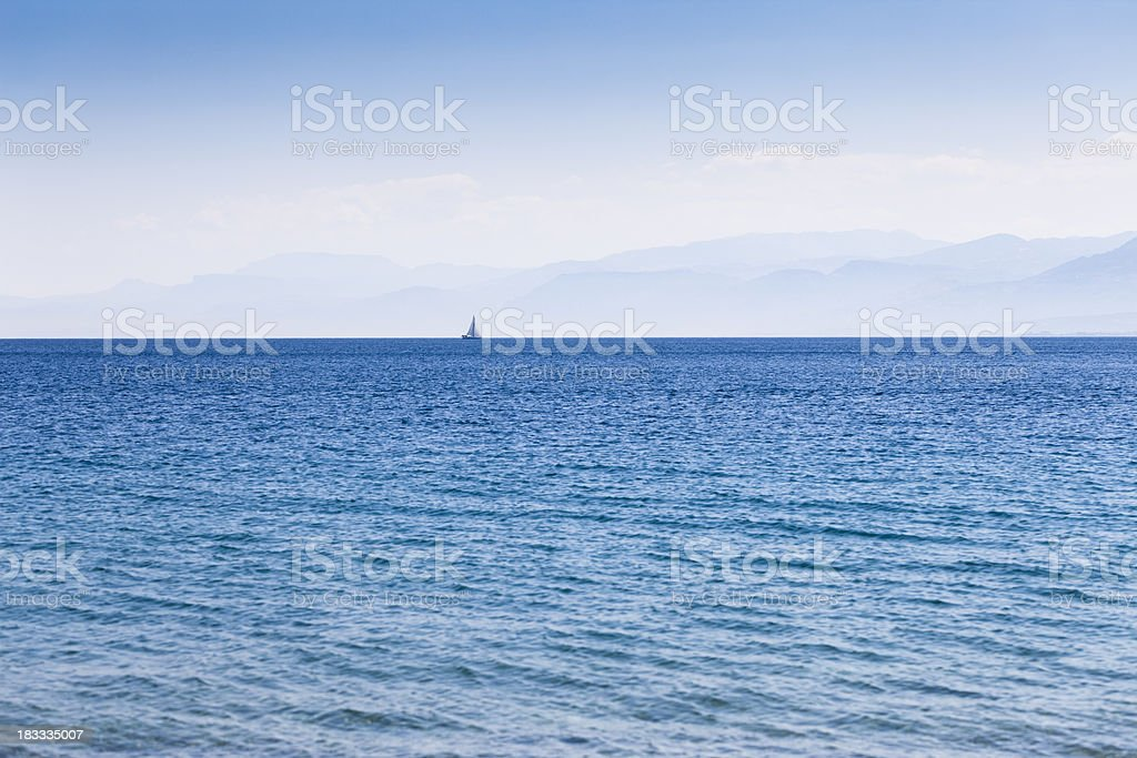 Sail Boat on the Horizon royalty-free stock photo