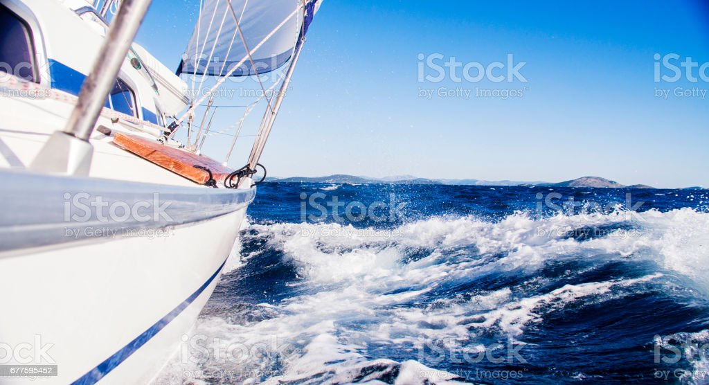 Sail boat sailing in sea on sunny day royalty-free stock photo