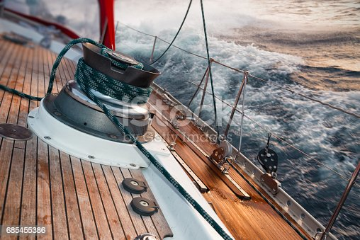 sail boat under the storm, detail on the winch