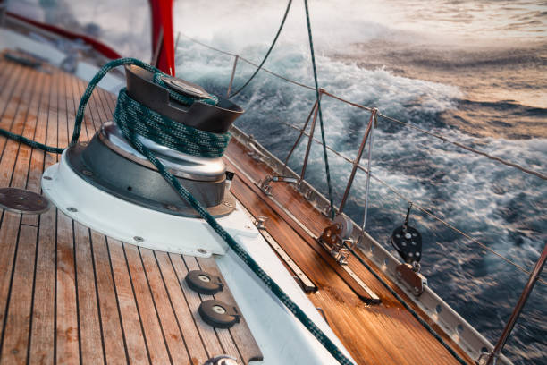 sail boat under the storm, detail on the winch stock photo